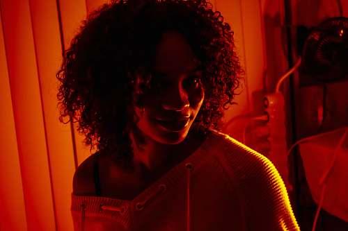 hair woman taking selfie afro hairstyle
