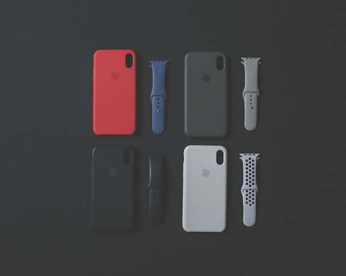 electronics four assorted-color iPhone Xs cases and sports bands mobile phone