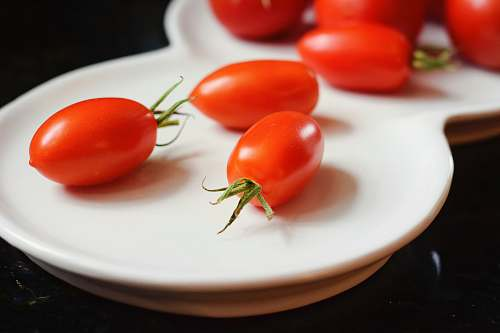 food cherry tomatoes on white plate tomato
