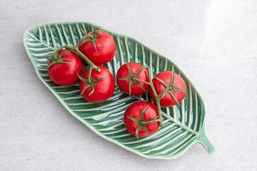 dish tomatoes on green leaf plate meal