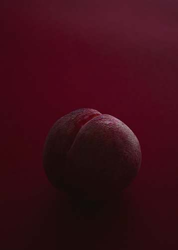 fruit brown ball on red surface food