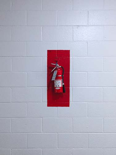 or red fire extinguisher on wall usa