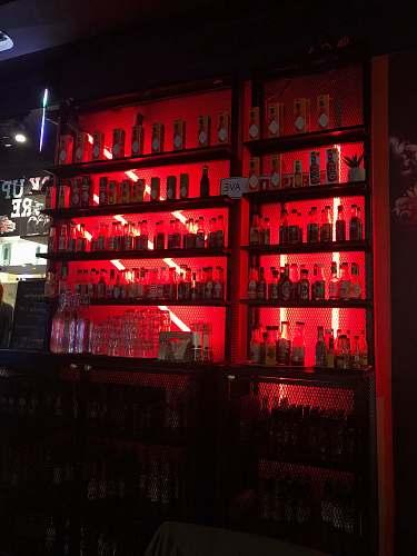 helsinki pile of liquor bottles in cabinet bar counter