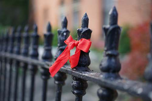 banister black metal fence with red ribbon handrail