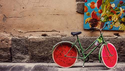 italy bicycle beside wall watermelon