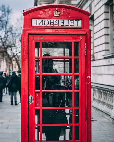 london closeup photo of red telephone booth phone booth