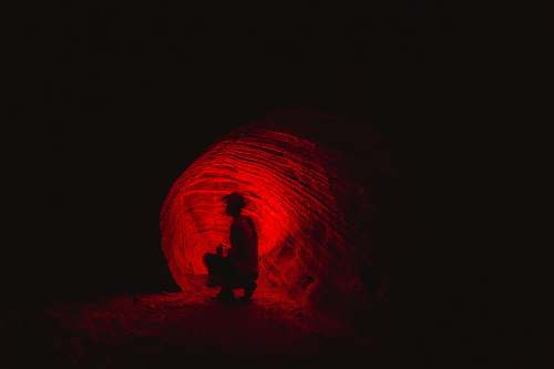 silhouette man in cave cave