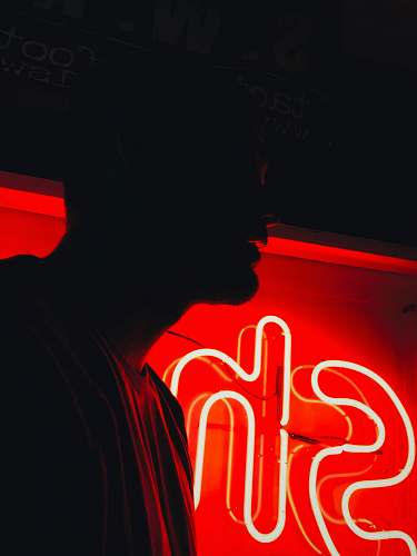 auburn man in front of red SH neon signage united states