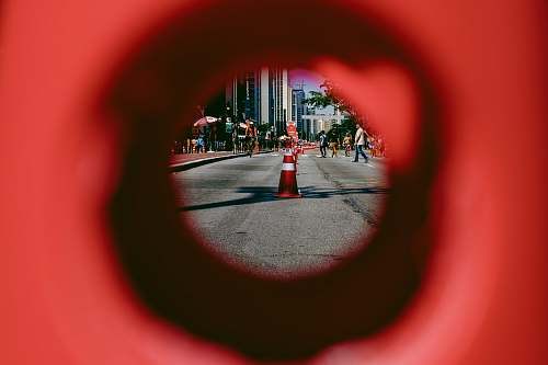 hole people walking near traffic cone on road during daytime paulista avenue
