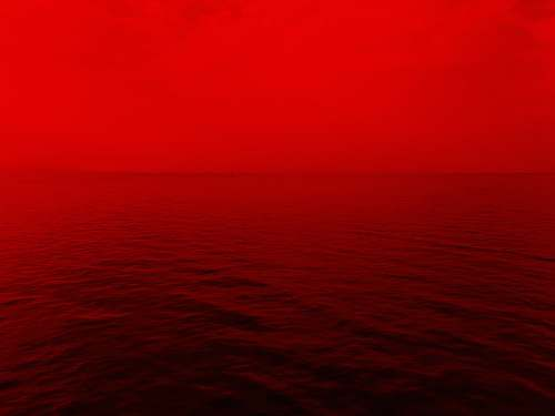 nature photo of ocean with red lights sky