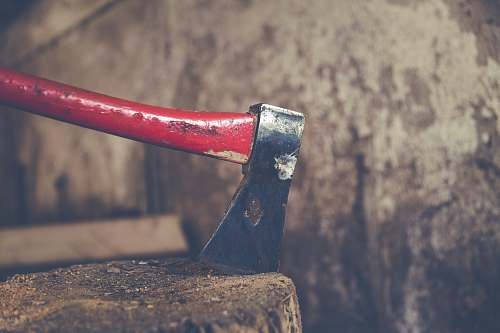 tool red and black axe on wood slab hatchet
