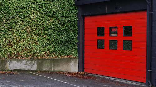 victoria red and black wooden shed beside grass canada