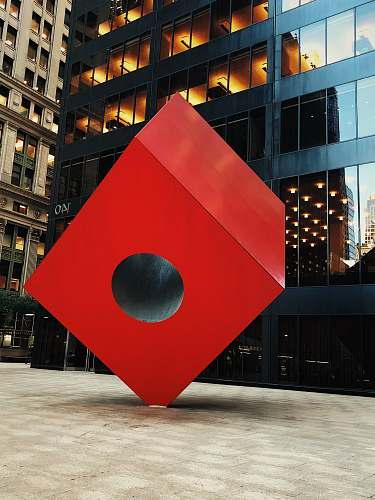 sphere red box decor near building road sign