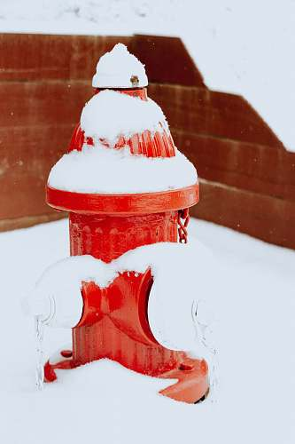 snow red fire hydrant covered with snow nature