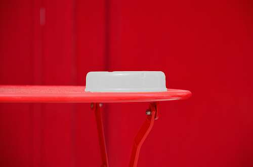 chair round white plastic container on red table furniture
