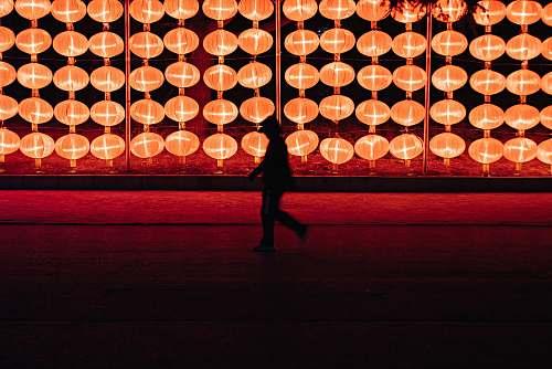 dalian silhouette of person walking near lantern lamp china