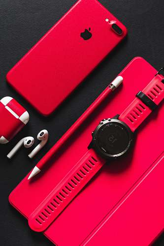 watch smartwatch, stylus, AirPods, and product red iPhone 7 on black surface pencil