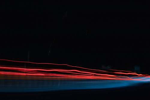 light time lapse photo of red lights line