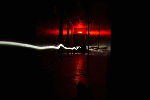 dark time lapse photography of corridor light trail