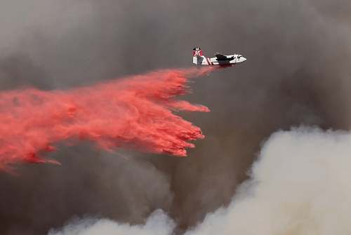 photo smoke white and red airplane pouring red powder on fire newbury park free for commercial use images