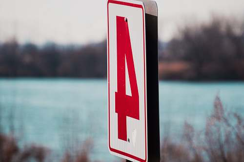 sign white and red number 4 signage in shallow focus photography overpeck county park