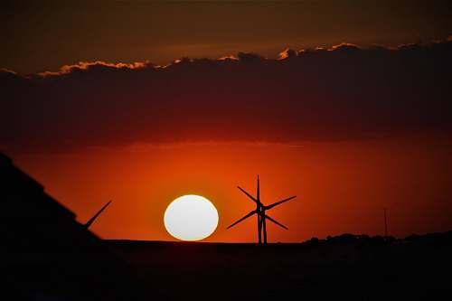 sunset windmill at golden hour sky