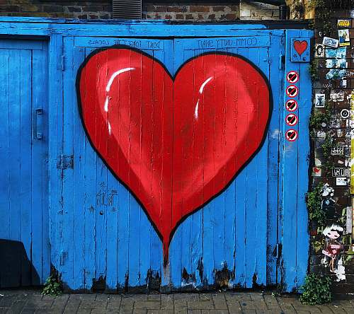 graffiti wooden gate with red and blue heart paint love