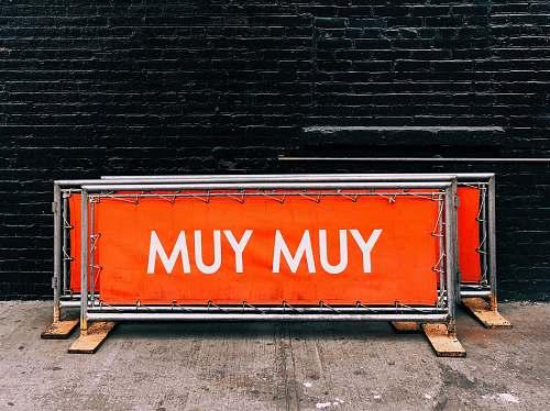 sign Yum Yum printed railing near wall decorative