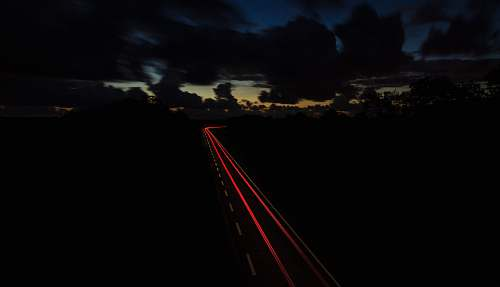 car time lapse photography of vehicle light evening
