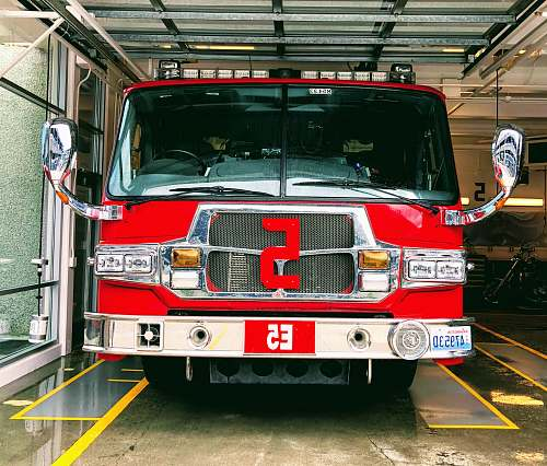 photo truck red and gray fire truck parked inside building fire truck free for commercial use images