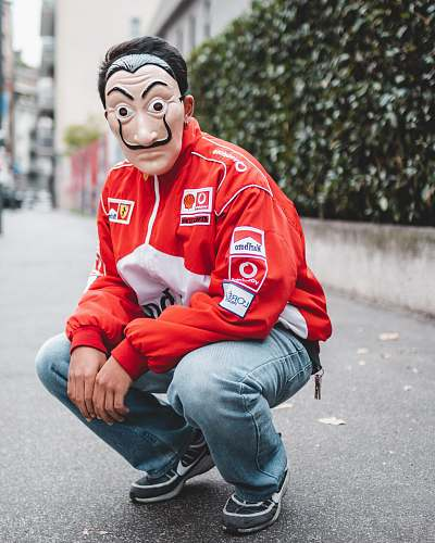 clothing selective focus photography of man wearing mask and red and white jacket apparel