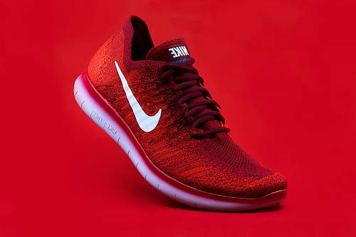 footwear unpaired red Nike sneaker apparel