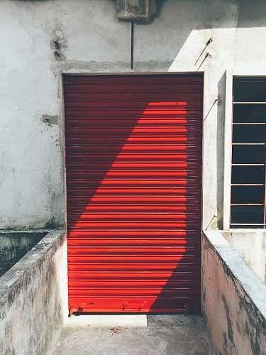 building closed red roller shutter entrance