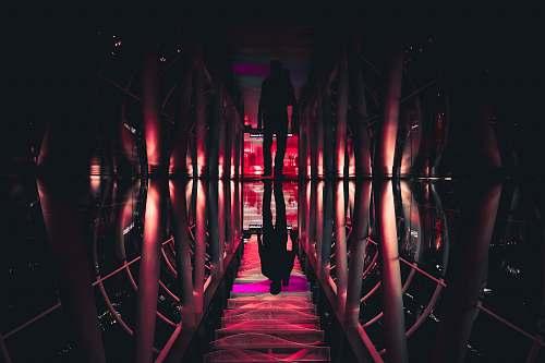 shadow man walking in pathway reflection