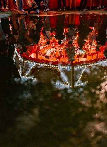 lantern people inside carnival during nighttime lamp