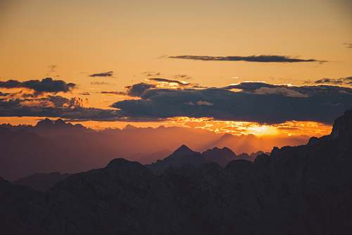 sunset aerial photography silhouette of mountains during sunset sunrise