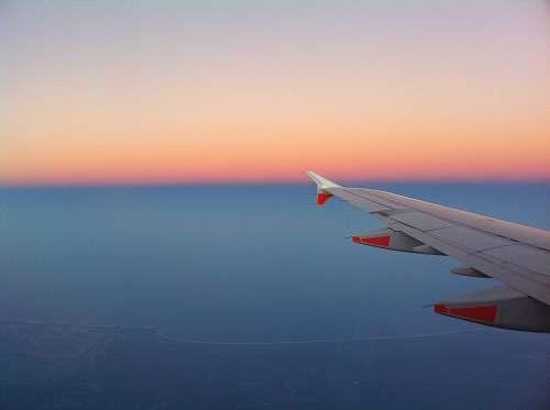 sunset airplane wing sunrise