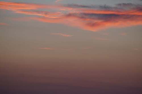 sunset orange clouds on clear sky dusk