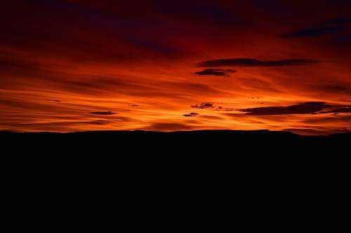 nature photography of orange clouds at golden hour outdoors