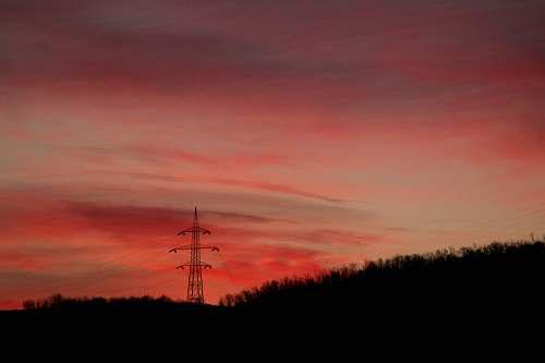 sunset silhouette of transmitter site dusk