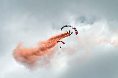 cloud worms eye view photography of people paragliding under cloudy sky parachute