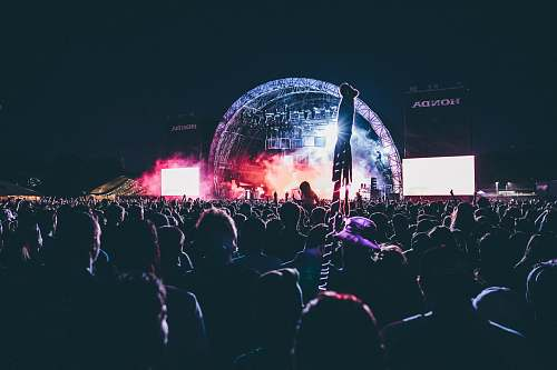 festival photo of crowd of people in a concert crowd