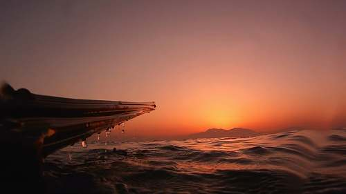 sunset silhouette of boat and water nature