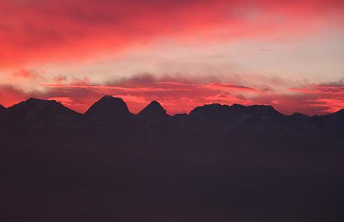 sunset silhouette of mountains during red sunset dawn