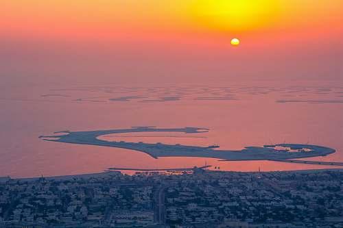 sky seaside city during sunset sunrise