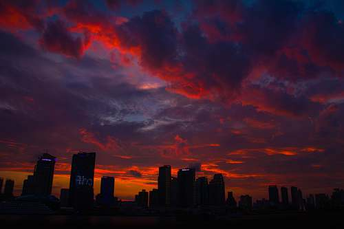 dawn silhouette of high rise buildings during golden hour sunrise