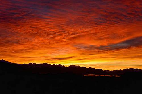 sky silhouette of mountains during golden hour sunrise