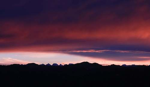 sunrise silhouette photograph of mountain ranges during golden hour nature
