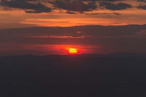 sunrise sunset under cloudy sky sun