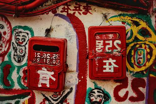 art two red cases on wall graffiti